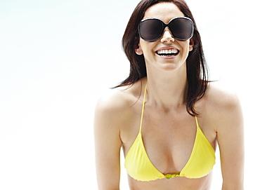 Brunette wearing bikini and sunglasses