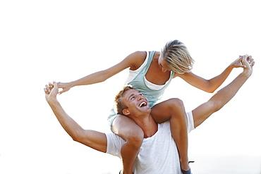 Man giving girlfriend a shoulder ride