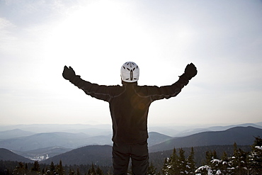 Snowboarder at top of ski hill