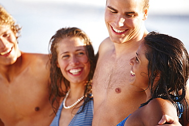 Young couples smiling on beach