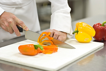 Chef chopping bell peppers