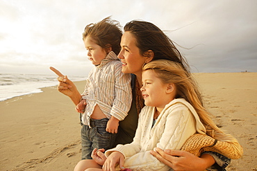 Mother and children at beach