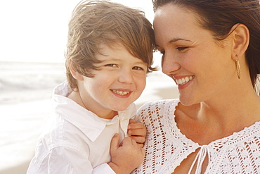 Close up of mother and son smiling