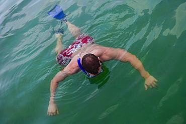 Man snorkeling in water