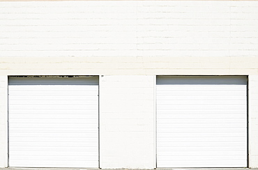 Close-up shot of closed roller doors of warehouse