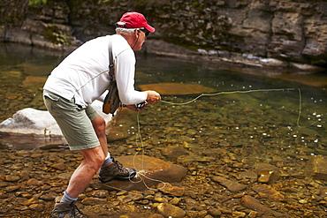Fisherman on riverbank, USA, Colorado