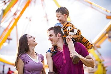 Happy Family with son (4-5) in amusement park, USA, Utah, Salt Lake City