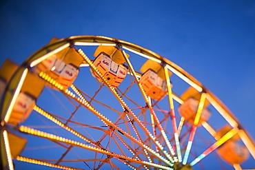 Ferris wheel in amusement park at dusk, USA, Utah, Salt Lake City