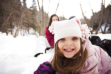 Portrait of Girl (2-3) grinning to camera, USA, Utah, Highland