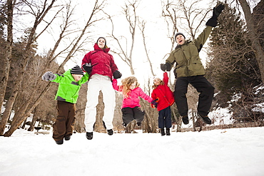 Three children (2-3, 4-5) with parents during stroll, USA, Utah, Highland