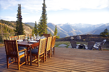 Outdoor table and chairs on wooden terrace, Colorado, United States