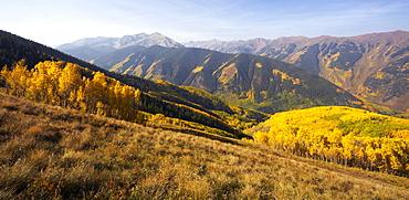 Mountain landscape with yellow aspen trees, Western Colorado, USA