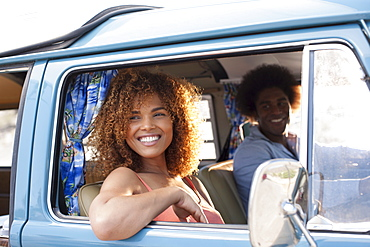 Smiling woman and man in van