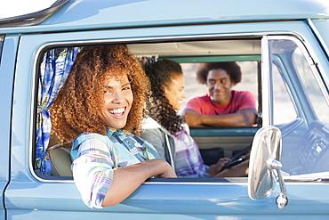 Three friends during their road trip