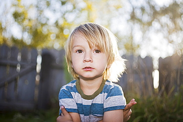 Toddler boy with arms crossed, Colorado, USA