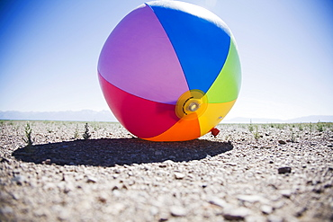 Beach ball in dry field, Colorado, USA