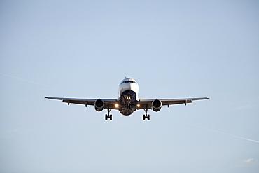 Commercial jet airliner flying towards camera