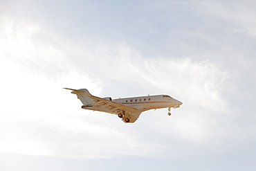 Private leer jet flying through air