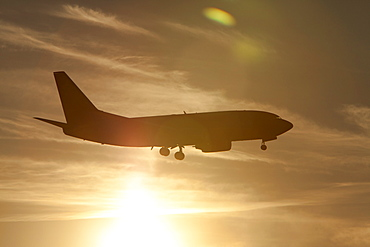 Silhouette of commercial jet flying