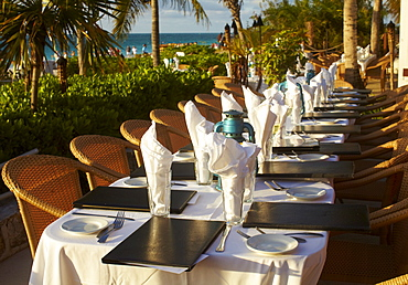 Beach resort outdoor restaurant table settings, Turks & Caicos, Providenciales