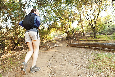 Woman with backpack on track, USA, California, Los Angeles