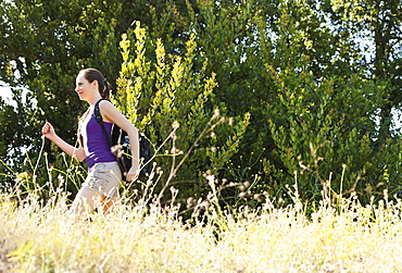 Woman running through meadow, USA, California, Los Angeles
