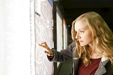 USA, California, Los Angeles, Woman at subway station checking map