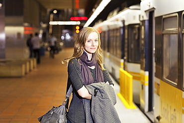 USA, California, Los Angeles, Woman standing on subway station