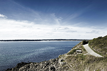 France, Brittany, Finistere Department, Bench, coastline and ocean