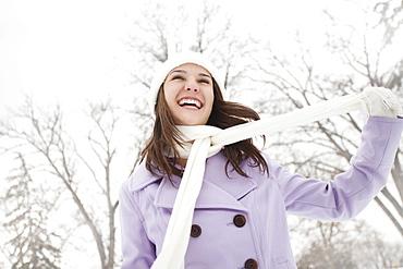 USA, Utah, Lehi, Young woman wearing winter coat outdoors