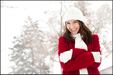 USA, Utah, Lehi, Portrait of young woman shivering in snow