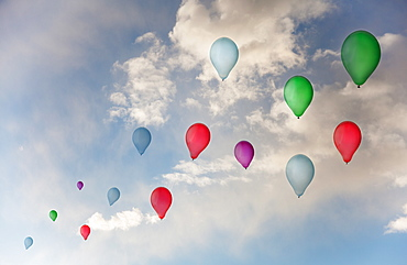 Balloons flying against sky