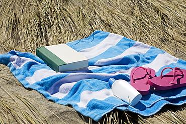 USA, Massachusetts, towel on Marram Grass