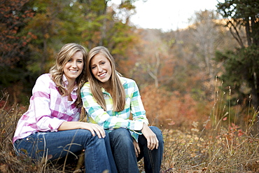 USA, Utah, Sundance, Portrait of two young women sitting on meadow