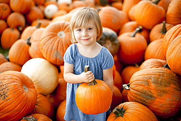 USA, Utah, Orem, portrait of girl (2-3) holding pumpkin
