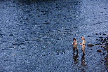 Canada, British Columbia, Fernie, Couple fly fishing in river