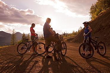 Canada, British Columbia, Fernie, group of four friends enjoying mountain biking