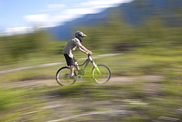Canada, British Columbia, Fernie, Young man riding on mountain bike