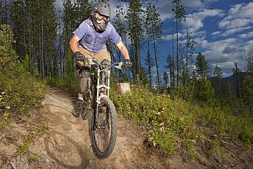 Canada, British Columbia, Fernie, Mid adult man enjoying mountain biking