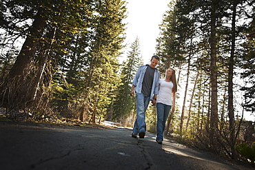 Couple walking hand in hand on a country road