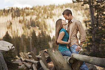 Happy couple embracing in rural setting