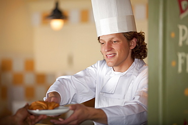 Chef serving pastry