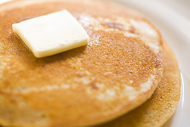 Pancakes and butter on plate