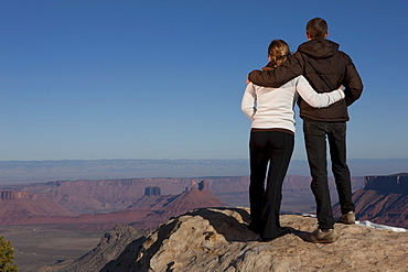 Couple looking at canyon