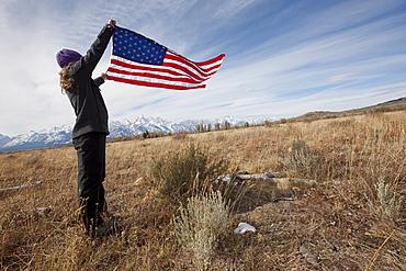 Hiker holding American flag