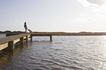 Woman and dog on pier
