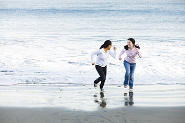 Girls running on beach
