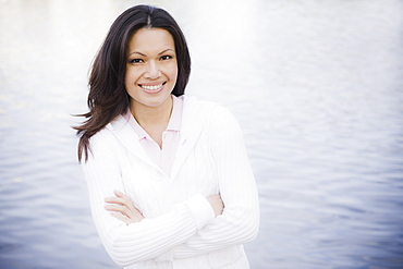 Portrait of woman smiling by sea