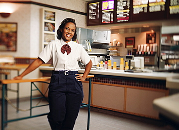 Young woman in restaurant, portrait