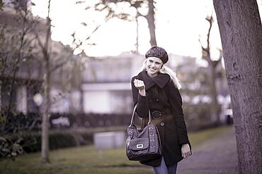 Smiling woman walking in park, Tilburg, The Netherlands